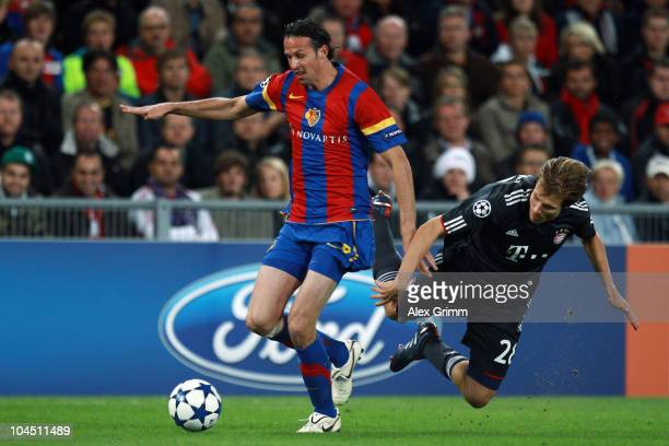 Marco Streller of Basel is challenged by Holger Badstuber of Muenchen during the UEFA Champions League group E match between FC Basel and FC Bayern...