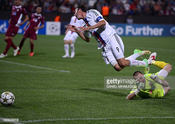 Marco Streller of FC Basel 1893 is tackeld in the penalty area by goalkeeper Mario Felgueiras of CFR Cluj 1907 during playoff football match of UEFA...