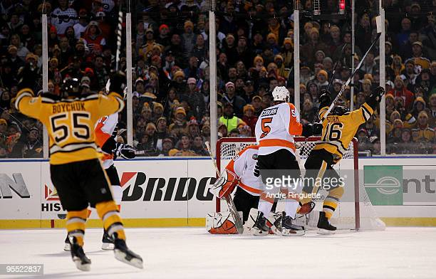 Marco Sturm and Johnny Boychuk of the Boston Bruins celebrate after Sturm scored the gamewinning goal in overtime to win 21 against goalie Michael...