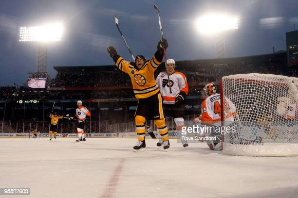 Marco Sturm of the Boston Bruins celebrates after he scored the gamewinning goal in overtime to win 21 against goalie Michael Leighton and Braydon...