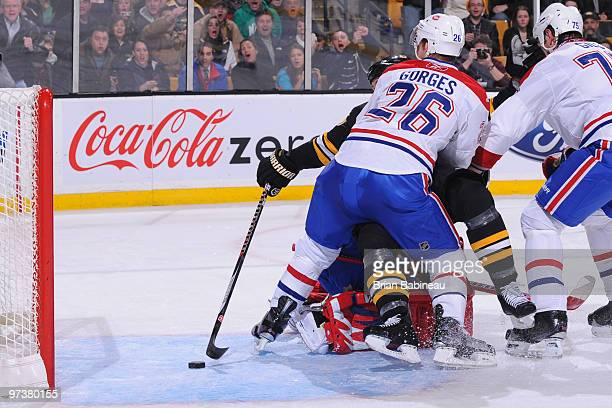 Marco Sturm of the Boston Bruins reaches around Josh Gorges of the Montreal Canadiens to score a goal at the TD Garden on March 2 2010 in Boston...