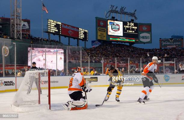 Marco Sturm of the Boston Bruins scores the gamewinning goal in overtime to win 21 against goalie Michael Leighton and Braydon Coburn of the...