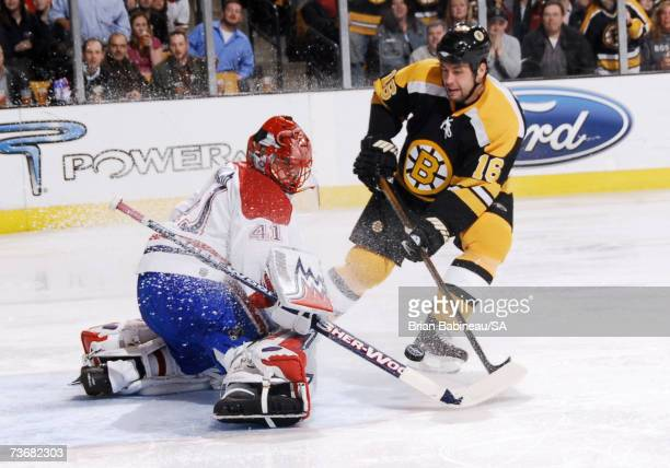 Marco Sturm of the Boston Bruins shoots against Jaroslav Halak of the Montreal Canadiens at the TD Banknorth Garden on March 22 2007 in Boston...