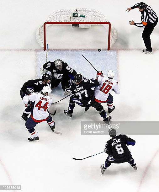 Marco Sturm of the Washington Capitals shoots the puck past Dwayne Roloson Brett Clark and Victor Hedman of the Tampa Bay Lightning during the first...