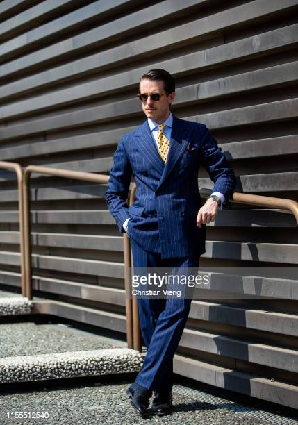 Marco Taddei is seen wearing navy striped suit during Pitti Immagine Uomo 96 on June 12 2019 in Florence Italy