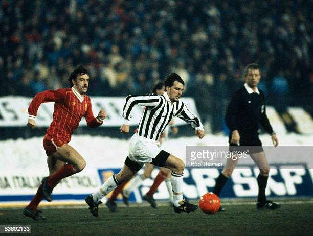 Marco Tardelli moves away from Liverpool's John Wark watched by the referee during the UEFA Super Final between Juventus and Liverpool at the Stadio...