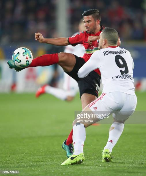 Marco Terrazzino of Freiburg is challenged by Kyriakos Papadopoulos of Hamburg during the Bundesliga match between SportClub Freiburg and Hamburger...