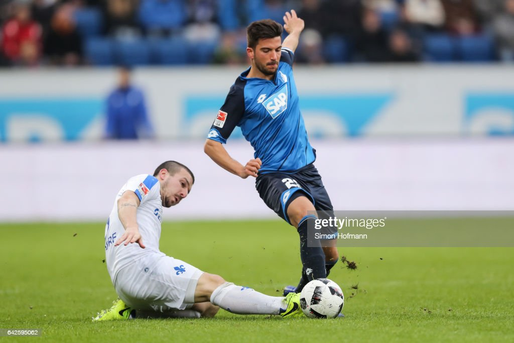 Marco Terrazzino of Hoffenheim is challenged by Jerome Gondorf of Darmstadt during the Bundesliga match between TSG 1899 Hoffenheim and SV Darmstadt 98 at Wirsol Rhein-Neckar-Arena on February 18, 2017 in Sinsheim, Germany.