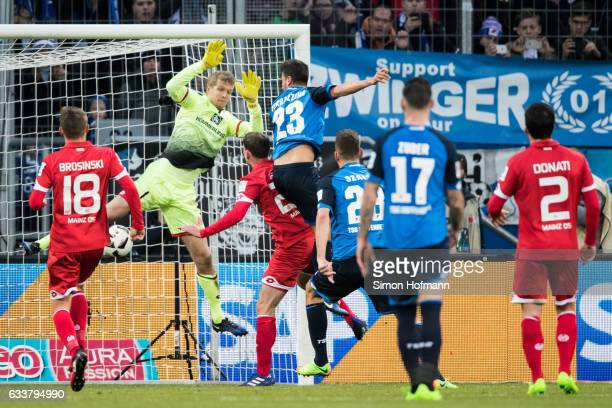 Marco Terrazzino of Hoffenheim scores his team's second goal against goalkeeper Jonas Loessl of Mainz during the Bundesliga match between TSG 1899...