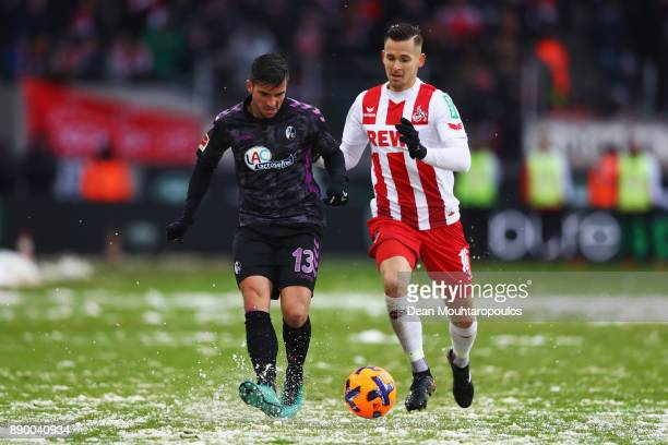 Marco Terrazzino of SC Freiburg battles for the ball with Pawel Olkowski of FC Koeln during the Bundesliga match between 1 FC Koeln and SportClub...