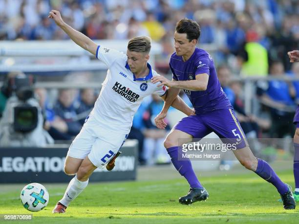 Marco Thiede of Karlsruhe and Clemens Fandrich of Aue compete for the ball during the 2 Bundesliga Playoff Leg 1 match between Karlsruher SC and...