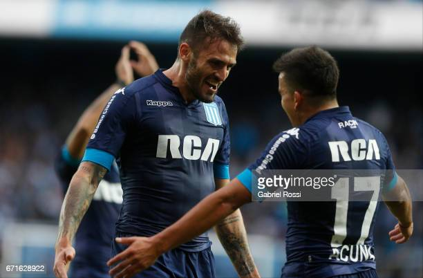 Marco Torsiglieri of Racing Club celebrates with Marcos Acuna after scoring the fourth goal of his team during a match between Racing and Atletico de...