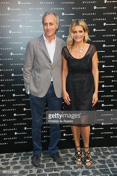 Marco Travaglio and Isabella Ferrari attends the 'Isabella Ferrari Forma/Luce' cocktail party at Horti Sallustiani on July 13, 2014 in Rome, Italy.