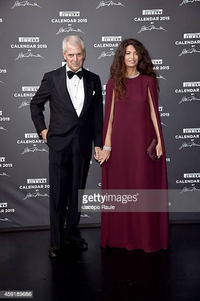 Marco Tronchetti Provera and Afef Jnifen attend the 2015 Pirelli Calendar Red Carpet on November 18 2014 in Milan Italy