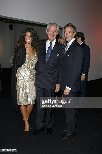 Marco Tronchetti Provera and Alessandro Benetton during United Colors of Benetton 40th Anniversary Fashion Show at Centre Pompidou in Paris France