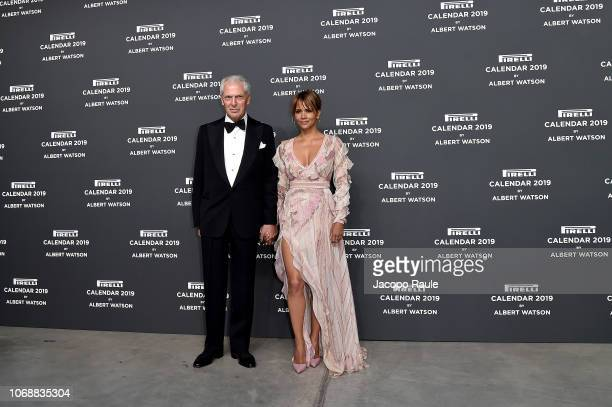 Marco Tronchetti Provera and Halle Berry walk the red carpet ahead of the 2019 Pirelli Calendar launch gala at HangarBicocca on December 5, 2018 in...