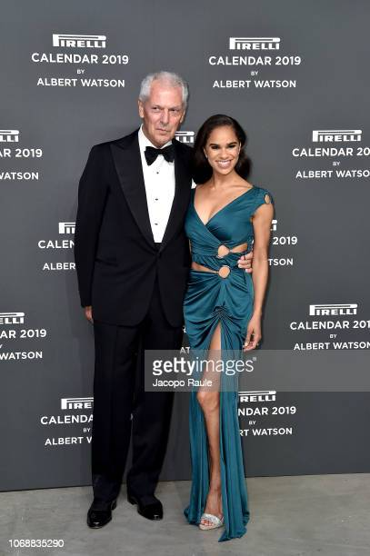 Marco Tronchetti Provera and Misty Copeland walk the red carpet ahead of the 2019 Pirelli Calendar launch gala at HangarBicocca on December 5, 2018...
