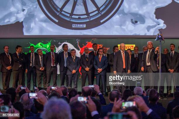 Marco Tronchetti Provera chief executive officer of Pirelli C SpA right rings the opening bell as part of the Pirelli C SpA launch ceremony to start...