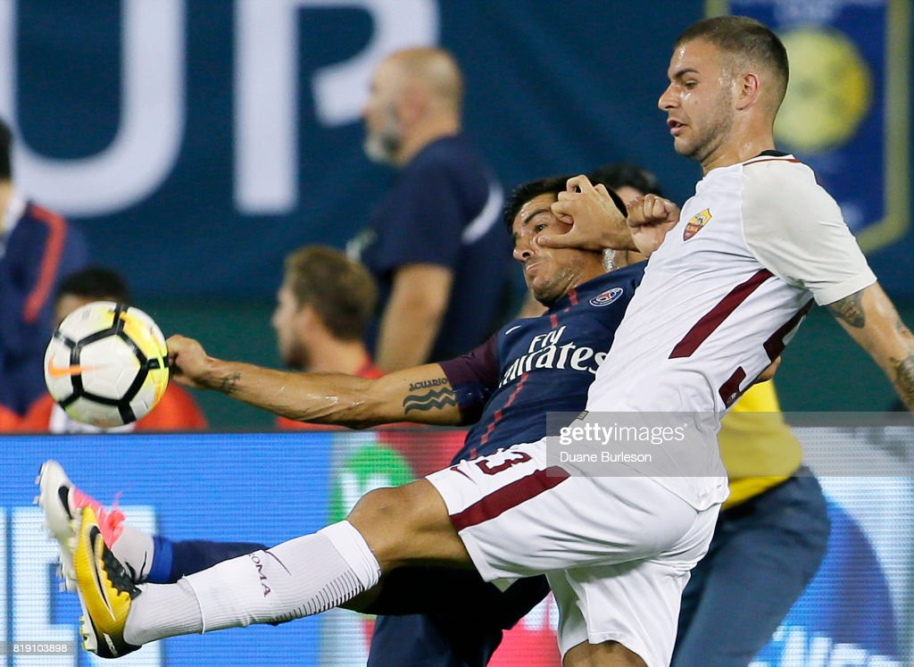 Marco Tumminello #93 (R) of AS Roma pushes off on Yuri Berchiche #17 of Paris Saint-Germain while going after the ball during the second half at Comerica Park on July 19, 2017 in Detroit, Michigan. After playing to a 1-1 tie, Paris Saint-Germain won the penalty kicks 5-3 for the victory.