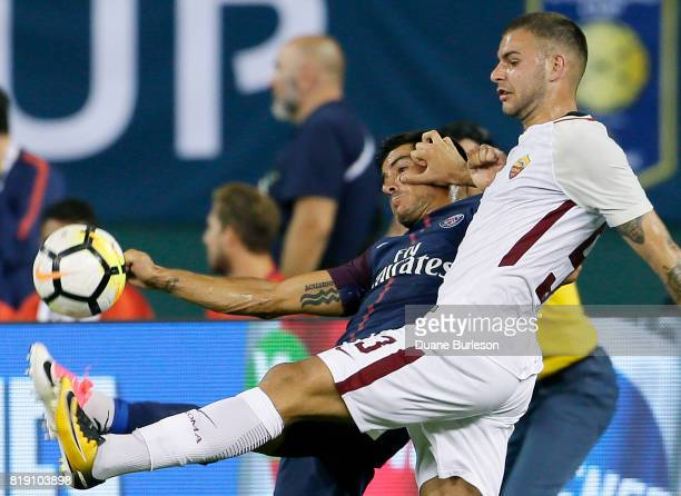 Marco Tumminello of AS Roma pushes off on Yuri Berchiche of Paris SaintGermain while going after the ball during the second half at Comerica Park on...