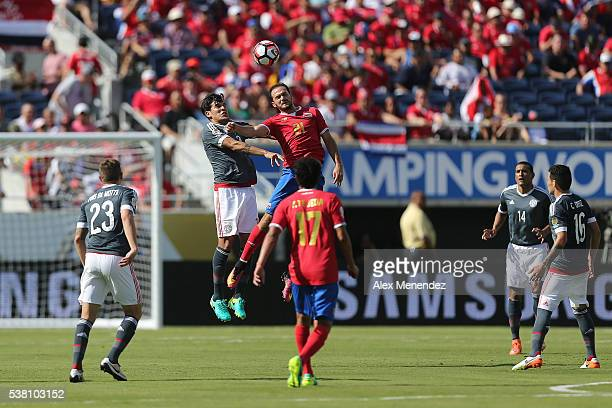 Marco Urena of Costa Rica and Gustavo Gomez of Paraguay fight for the ball during the 2016 Copa America Centenario Group A match between Costa Rica...
