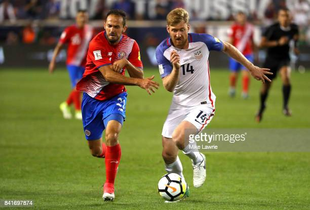Marco Urena of Costa Rica and Tim Ream of the United States compete for the ball in the second half during the FIFA 2018 World Cup Qualifier at Red...
