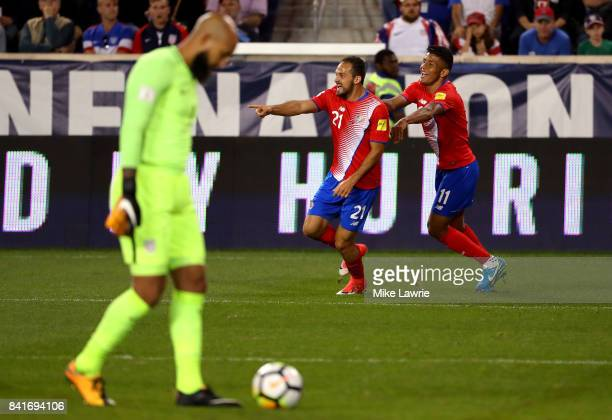 Marco Urena of Costa Rica celebrates scoring his team's second goal against the United States with teammate Johan Venegas during the FIFA 2018 World...