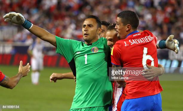 Marco Urena of Costa Rica celebrates scoring his team's second goal with teammates Keylor Navas and Jose Salvatierra in the second half against the...