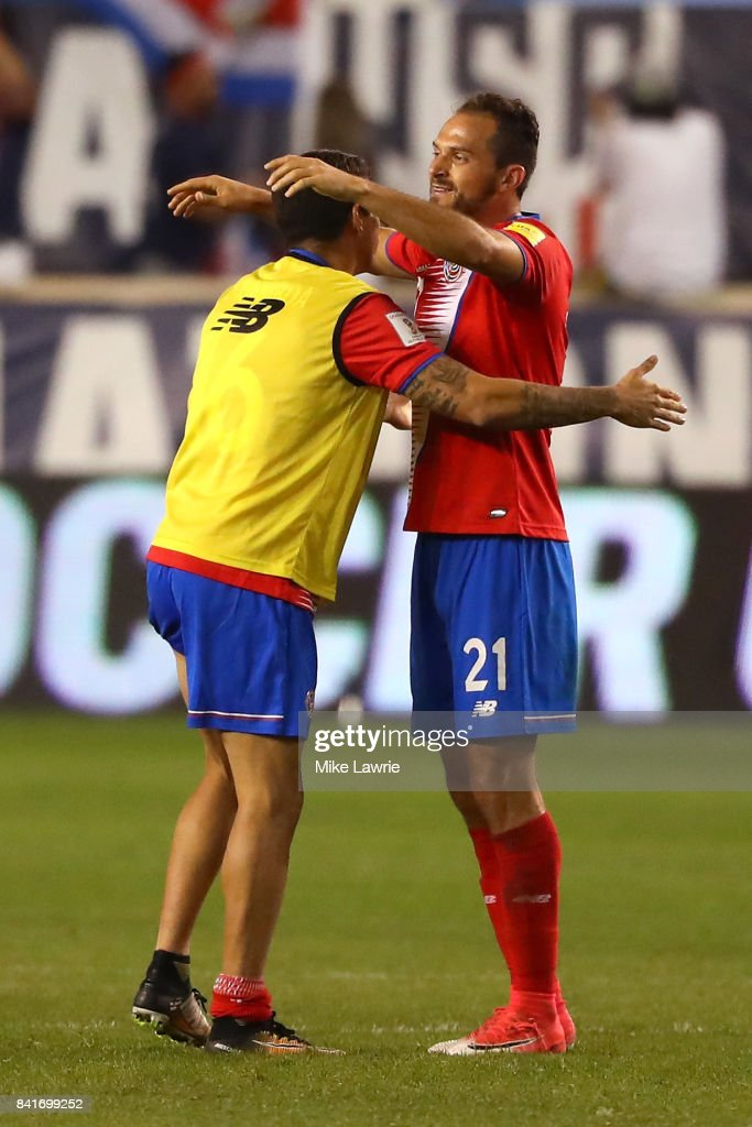 Marco Urena #21 of Costa Rica celebrates with a teammate after defeating the United States 2-0 during the FIFA 2018 World Cup Qualifier at Red Bull Arena on September 1, 2017 in Harrison, New Jersey.