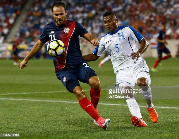 Marco Urena of Costa Rica fights for the ball with Ever Alvarado of Honduras during their CONCACAF Gold Cup match at Red Bull Arena on July 7 2017 in...
