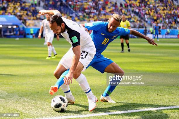 Marco Urena of Costa Rica is challenged by Neymar of Brazil during the 2018 FIFA World Cup Russia group E match between Brazil and Costa Rica at...