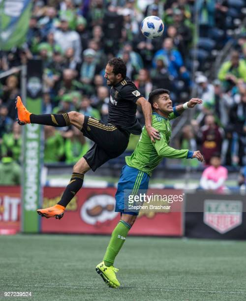 Marco Urena of Los Angeles FC and Tony Alfaro of the Seattle Sounders go up for a header during the first half of a match at CenturyLink Field on...