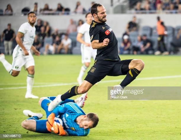 Marco Urena of Los Angeles FC breaks in on goal as Jeff Attinella of Portland Timbers makes a save during the U.S. Open Cup Quarterfinal between Los...