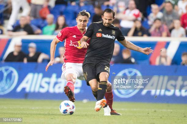 August 5: Marco Urena of Los Angeles FC challenged by Aaron Long of New York Red Bulls during the New York Red Bulls Vs Los Angeles FC MLS regular...