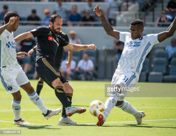 Marco Urena of Los Angeles FC has a shot blocked by Harold Cummings of San Jose Earthquakes during the MLS match at the Banc of California Stadium on...