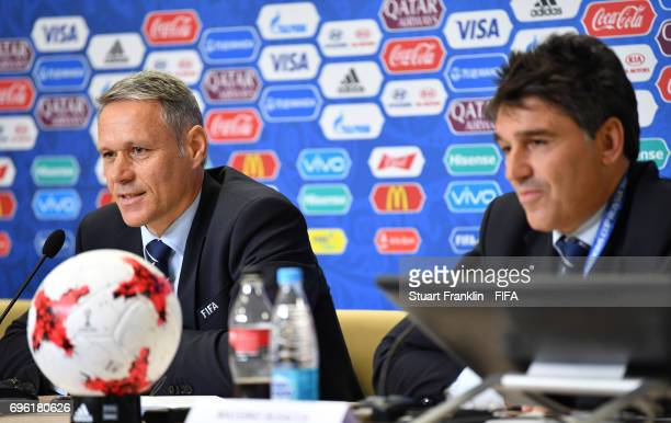 Marco van Basten, FIFA technical director looks on as Massimo Busacca , FIFA head of refereeing talks with the media during a press conference about...