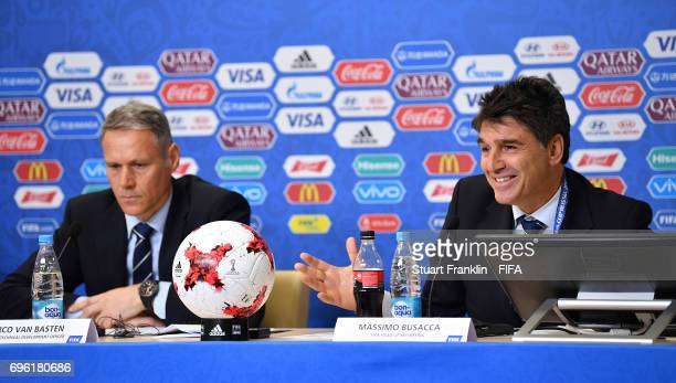 Marco van Basten FIFA technical director looks on as Massimo Busacca FIFA head of refereeing talks with the media during a press conference about...