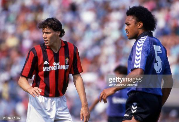 Marco Van Basten of AC Milan and Paul Elliott of Pisa during the Serie A, Italy.