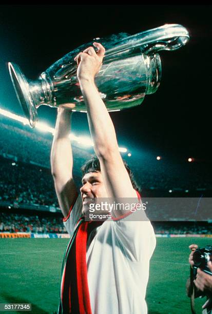 Marco Van Basten of AC Milan celebrates with the trophy after winning the European Cup Final match against Steaua Bucuresti at Nou Camp in Barcelona...