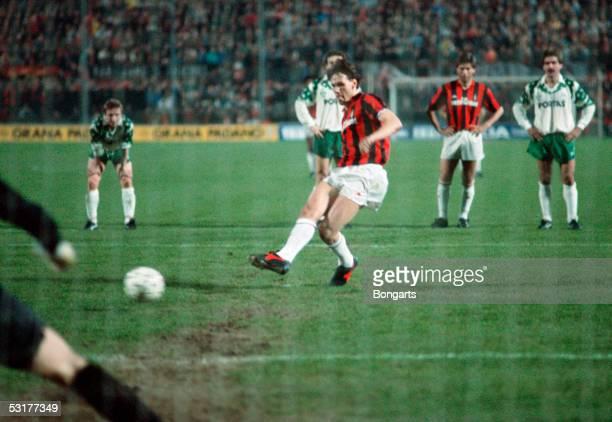 Marco Van Basten of AC Milan scores the 1st goal per penalty during the European Cup quarterfinal match against SV Werder Bremen at San Siro in Milan...
