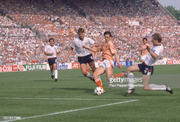 Marco van Basten of the Netherlands scores as Gary Stevens and Tony Adams attempt to stop him during the UEFA Euro 88 Group 2 match at the...