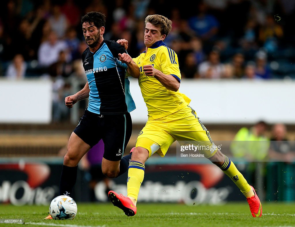 Marco van Ginkel of Chelsea battles with Aaron Pierre of Wycombe duing the pre season friendly match between Wycombe Wanderers and Chelsea at Adams Park on July 16, 2014 in High Wycombe, England.