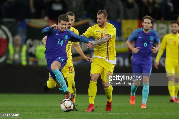 Marco van Ginkel of Holland Denis Alibec of Romania during the International Friendly match between Romania v Holland at the Arena Nationala on...