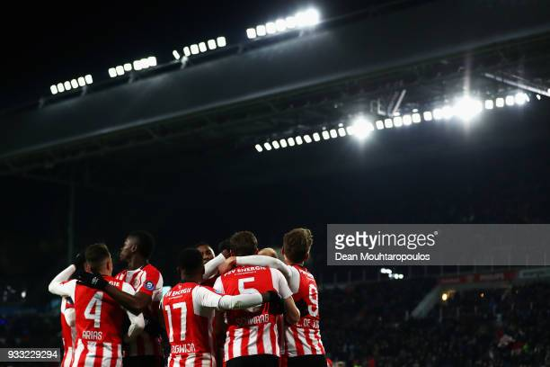 Marco van Ginkel of PSV celebrates scoring his teams first goal of the game with team mates during the Dutch Eredivisie match between PSV Eindhoven...