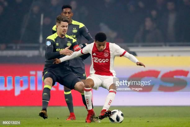 Marco van Ginkel of PSV David Neres of Ajax during the Dutch Eredivisie match between Ajax v PSV at the Johan Cruijff Arena on December 10 2017 in...