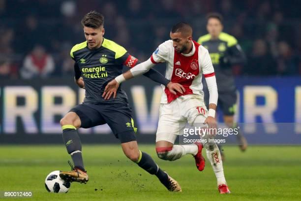 Marco van Ginkel of PSV Hakim Ziyech of Ajax during the Dutch Eredivisie match between Ajax v PSV at the Johan Cruijff Arena on December 10 2017 in...