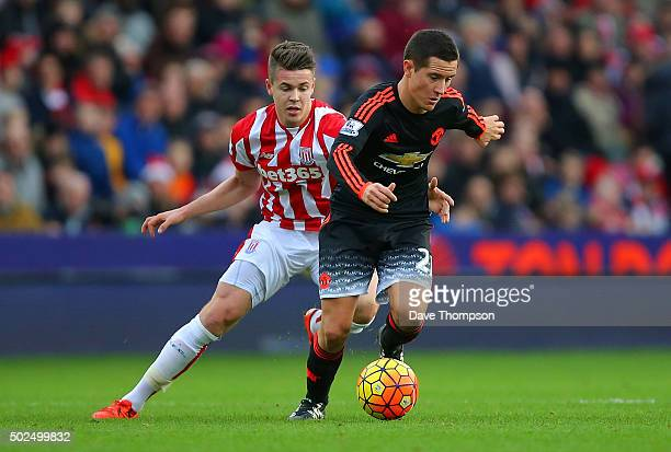 Marco van Ginkel of Stoke City battles for the ball with Ander Herrera of Manchester United during the Barclays Premier League match between Stoke...