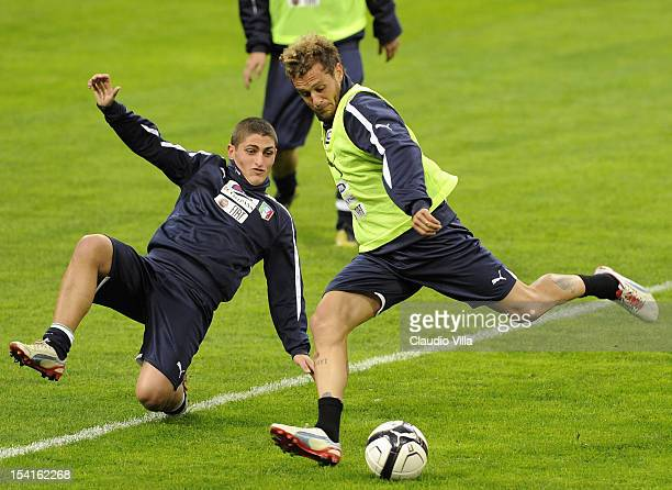 Marco Verratti and Alessandro Diamanti of Italy attend a training session ahead of their FIFA World Cup Brazil 2014 qualifier against Danimarca at...