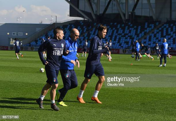 Marco Verratti and Federico Chiesa of Italy in action during a training session at Manchester City Football Academy on March 25 2018 in Manchester...