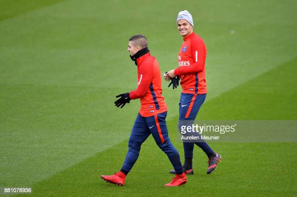 Marco Verratti and Hatem Ben Arfa react during a Paris SaintGermain training session at Centre Ooredoo on November 28 2017 in Paris France